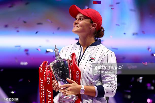 Ashleigh Barty of Australia celebrates with the Billie Jean King trophy after her Women's Singles final match victory against Elina Svitolina of...