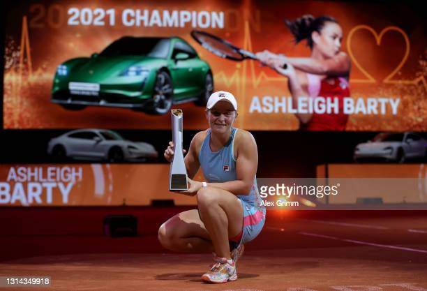Ashleigh Barty of Australia celebrates with the trophy after winning the final match against Aryna Sabalenka of Belarus during day 9 of the Porsche...