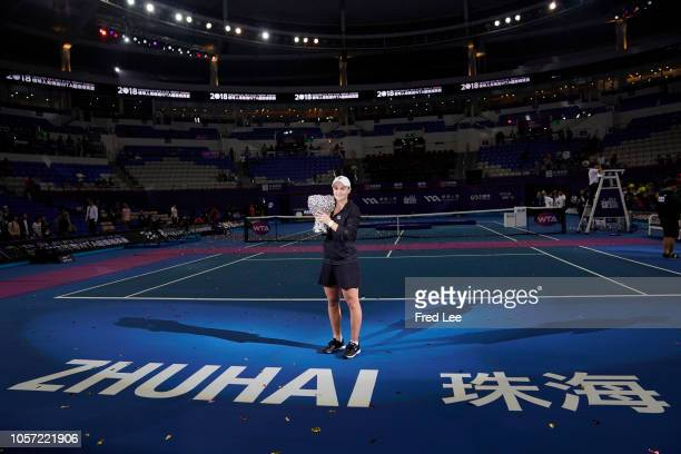 Ashleigh Barty of Australia celebrates with the trophy during the Award Ceremony after winning the women's singles final match against Qiang Wang of...