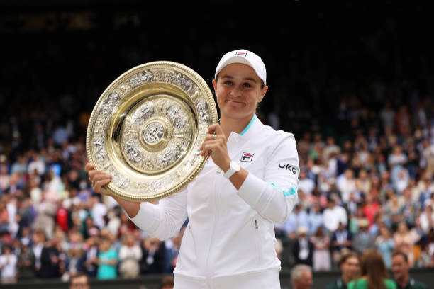 Ashleigh Barty of Australia celebrates with the Venus Rosewater Dish trophy after winning her Ladies' Singles Final match against Karolina Pliskova...