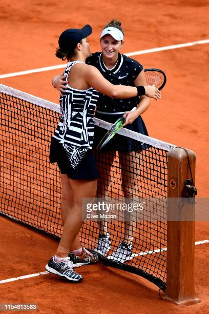 Ashleigh Barty of Australia embraces Marketa Vondrousova of The Czech Republic following victory in the ladies singles final during Day fourteen of...