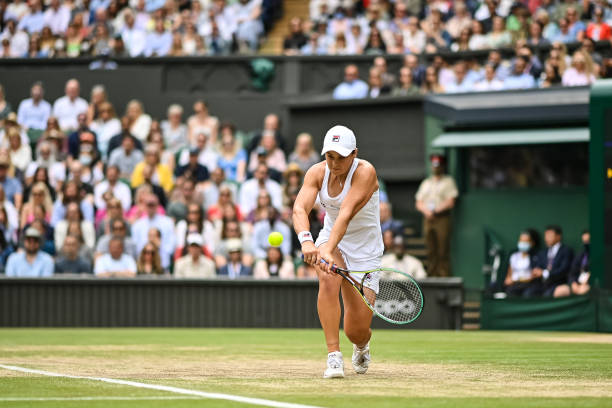 Ashleigh Barty of Australia hits a backhand against Angelique Kerber of Germany in the semi-finals of the ladies singles during Day Ten of The...