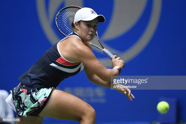 Ashleigh Barty of Australia hits a return against Agnieszka Radwanska of Poland during their third round women's singles match at the WTA Wuhan Open...