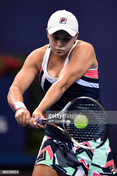 Ashleigh Barty of Australia hits a return against Angelique Kerber of Germany during their women's singles match at the Zhuhai Elite Trophy tennis...