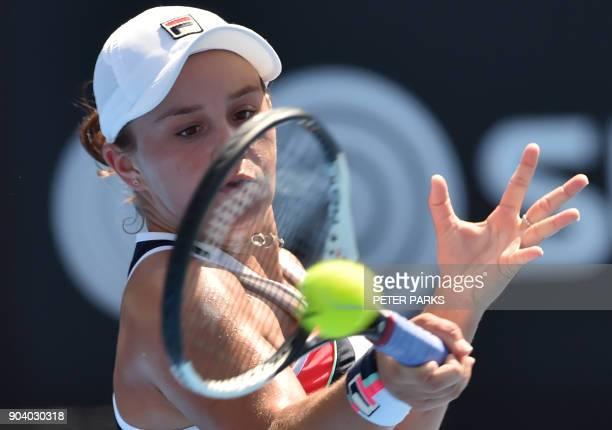 Ashleigh Barty of Australia hits a return against Australia's Daria Gavrilova during their women's singles semi-final match at the Sydney...