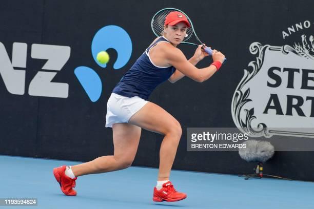 Ashleigh Barty of Australia hits a return to Anastasia Pavlyuchenkova of Russia during their women's second round singles match at the Adelaide...