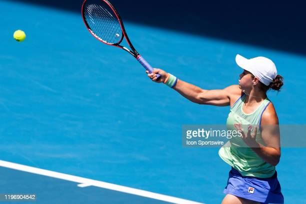 Ashleigh Barty of Australia hits a volley during quarterfinals of the Australian Open Tennis at Melbourne Park Tennis Centre on January 28, 2020 in...