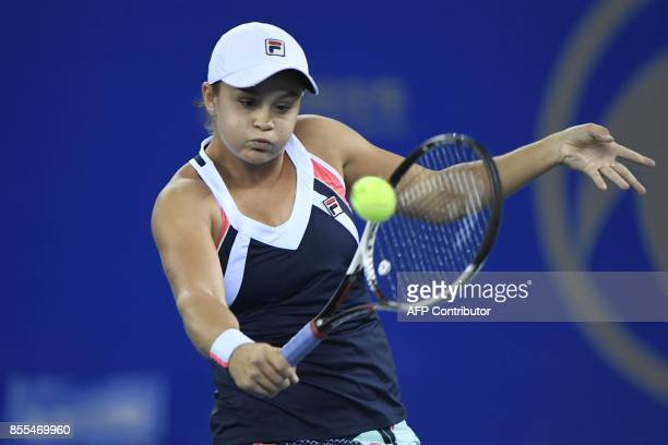 Ashleigh Barty of Australia hits areturn against Jelena Ostapenko of Latvia during their women's singles semifinals match at the WTA Wuhan Open...