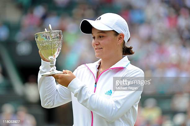 Ashleigh Barty of Australia holds up her trophy after winning her final round Girls' match against Irina Khromacheva of Russia on Day Thirteen of the...