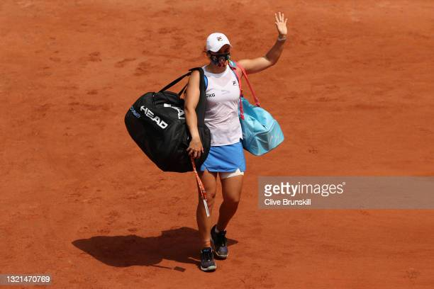 Ashleigh Barty of Australia leaves the court injured during her women's second round match against Magda Linette of Poland during day five of the...