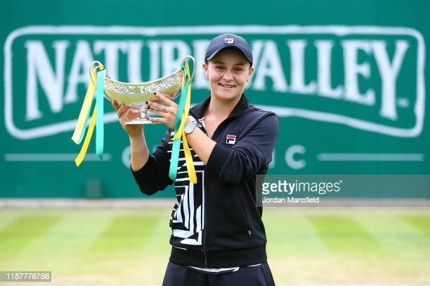 Ashleigh Barty of Australia lifts the Maud Watson Trophy after victory in her final match against Julia Goerges of Germany on day seven of the Nature...