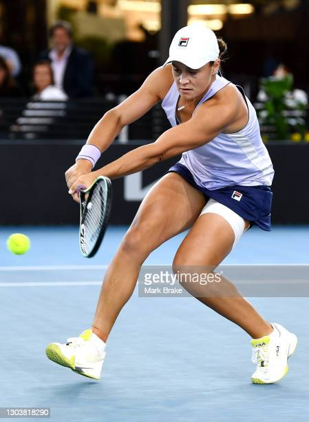 Ashleigh Barty of Australia plays a back hand during her match against Danielle Collins of the USA on day three of the Adelaide International WTA 500...