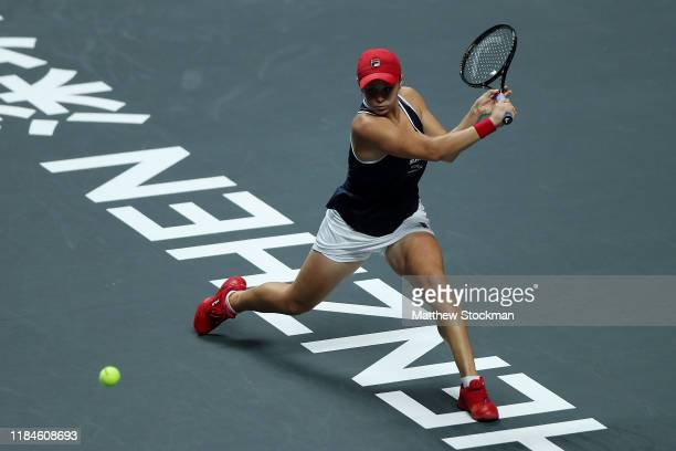 Ashleigh Barty of Australia plays a backhand against Petra Kvitova of the Czech Republic during their Women's Singles match on Day Five of the 2019...