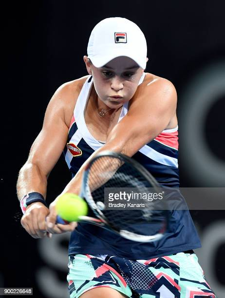 Ashleigh Barty of Australia plays a backhand in her match against Lesia Tsurenko of Ukraine during day two of the 2018 Brisbane International at Pat...