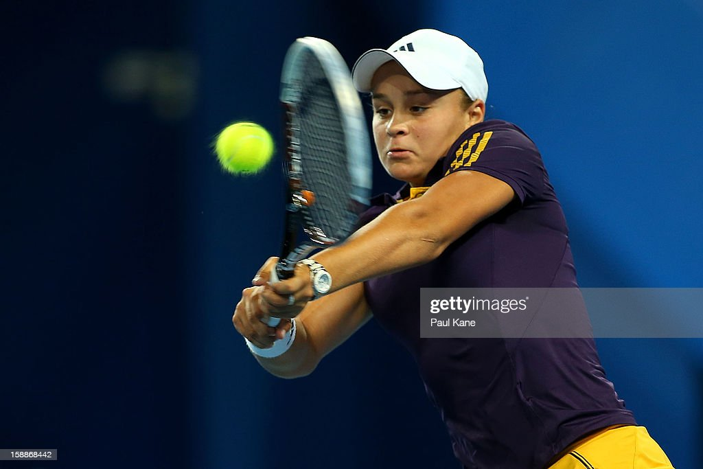 Ashleigh Barty of Australia plays a backhand in her singles match against Ana Ivanovic of Serbia during day five of the Hopman Cup at Perth Arena on January 2, 2013 in Perth, Australia.