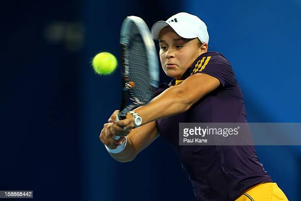Ashleigh Barty of Australia plays a backhand in her singles match against Ana Ivanovic of Serbia during day five of the Hopman Cup at Perth Arena on...