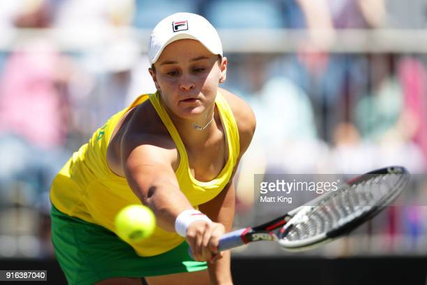 Ashleigh Barty of Australia plays a backhand in her singles match against Lyudmyla Kichenok of Ukraine during the Fed Cup tie between Australia and...
