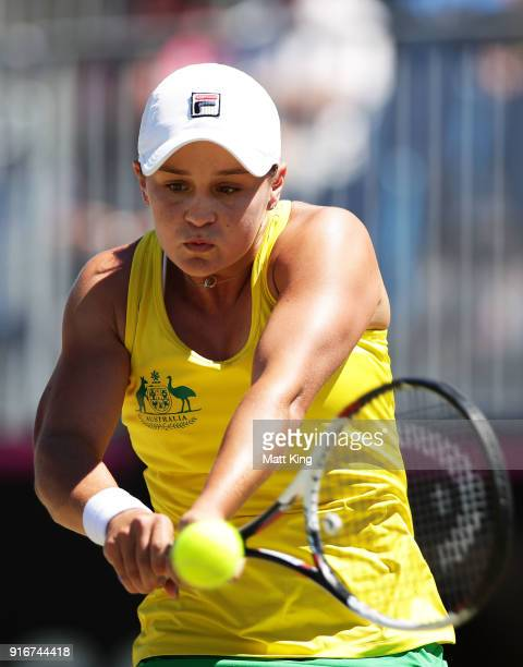 Ashleigh Barty of Australia plays a backhand in her singles match against Marta Kostyuk of Ukraine during the Fed Cup tie between Australia and the...