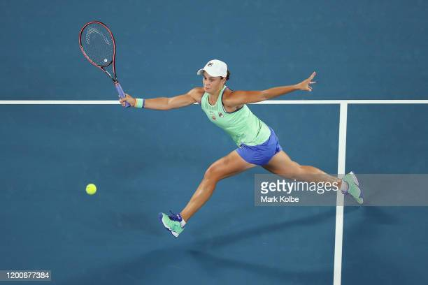 Ashleigh Barty of Australia plays a forehand during her Women's Singles first round match against Lesia Tsurenko of Ukraine on day one of the 2020...