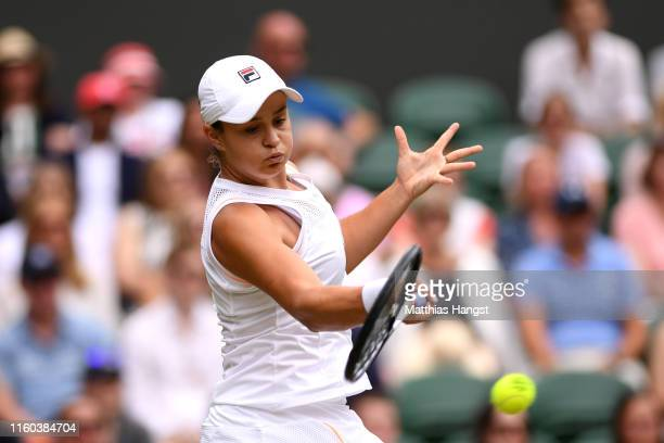 Ashleigh Barty of Australia plays a forehand in her Ladies' Singles third round match against Harriet Dart of Great Britain during Day six of The...