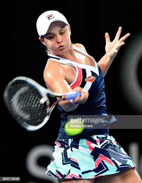 Ashleigh Barty of Australia plays a forehand in her match against Lesia Tsurenko of Ukraine during day two of the 2018 Brisbane International at Pat...