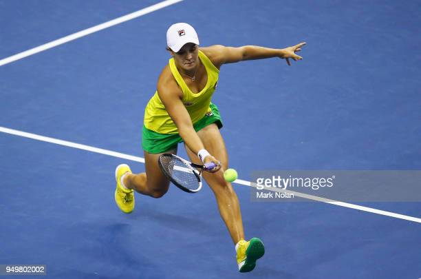 Ashleigh Barty of Australia plays a forehand in her match against Lesley Kerkhove of the Netherlands during the World Group PlayOff Fed Cup tie...