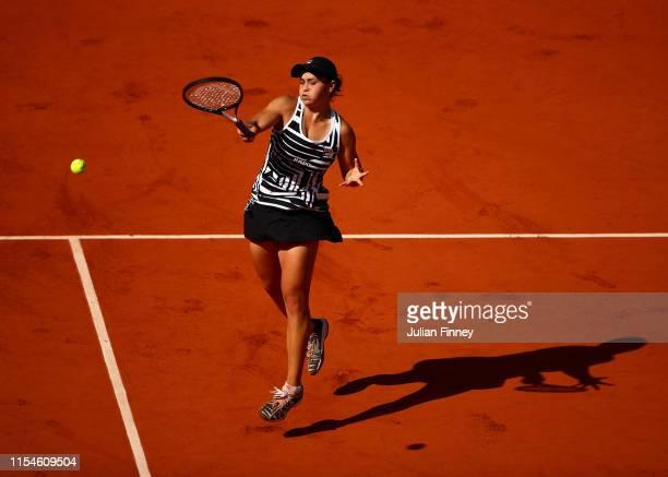 Ashleigh Barty of Australia plays a smash during the ladies singles final against Marketa Vondrousova of The Czech Republic during Day fourteen of...