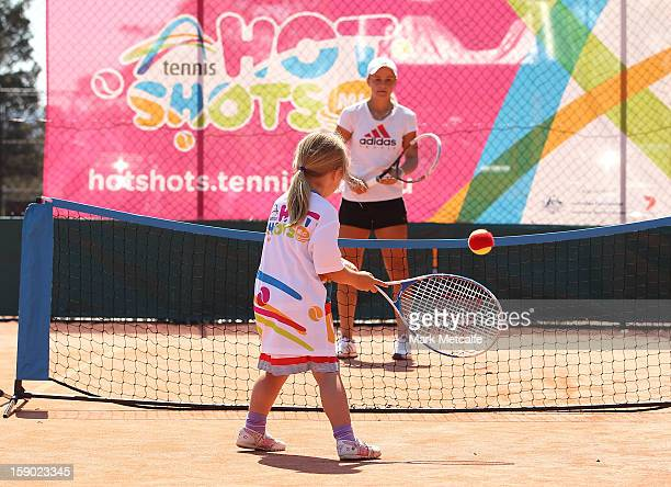 Ashleigh Barty of Australia plays Tennis Hot Shots with children as part of kids tennis day during day three of the Hobart International at Domain...