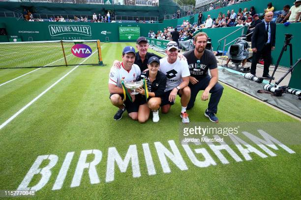 Ashleigh Barty of Australia poses for a photo with her team and the Maud Watson Trophy after victory in her final match against Julia Goerges of...