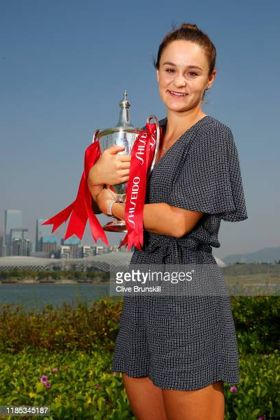 Ashleigh Barty of Australia poses for a photo with the Billie Jean King trophy following her victory in the Women's Singles final of the 2019...