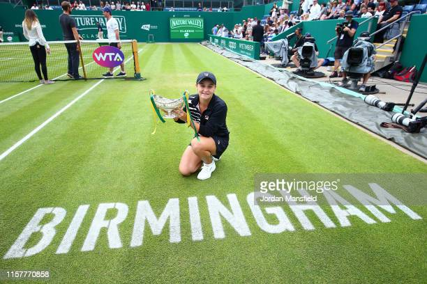 Ashleigh Barty of Australia poses for a photo with the Maud Watson Trophy after victory in her final match against Julia Goerges of Germany on day...