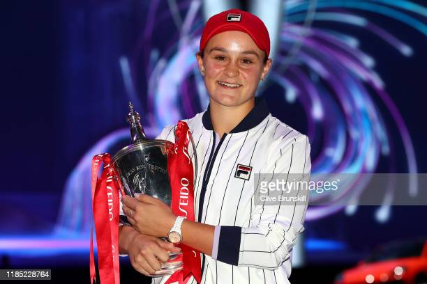 Ashleigh Barty of Australia poses for photos as she celebrates with the Billie Jean King trophy after her Women's Singles final match victory against...