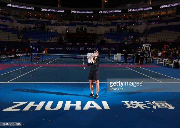 Ashleigh Barty of Australia poses with her trophy after defeating Wang Qiang of China in the Women's Single final match on Day 6 of 2018 WTA Elite...