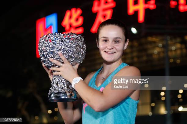 Ashleigh Barty of Australia poses with her trophy outside The Zhuhai Hengqin International Tennis Centre afte winning the Women's Single final match...