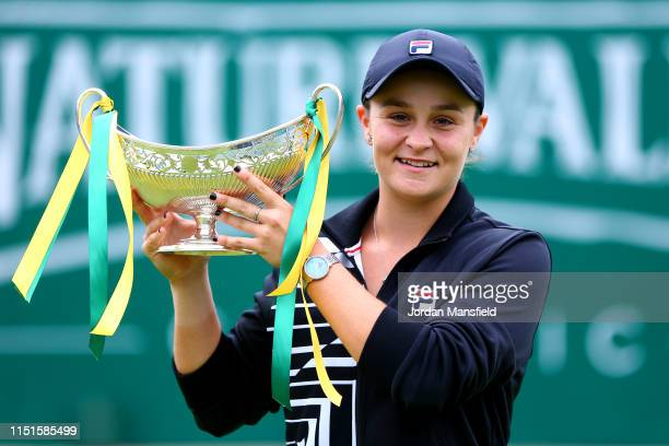Ashleigh Barty of Australia poses with the trophy following her victory in the final match during day seven of the Nature Valley Classic at Edgbaston...