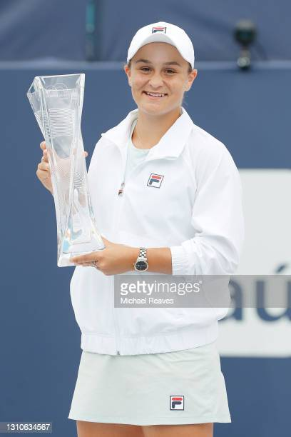 Ashleigh Barty of Australia poses with the winner's trophy after defeating Bianca Andreescu of Canada during the final of the Miami Open at Hard Rock...