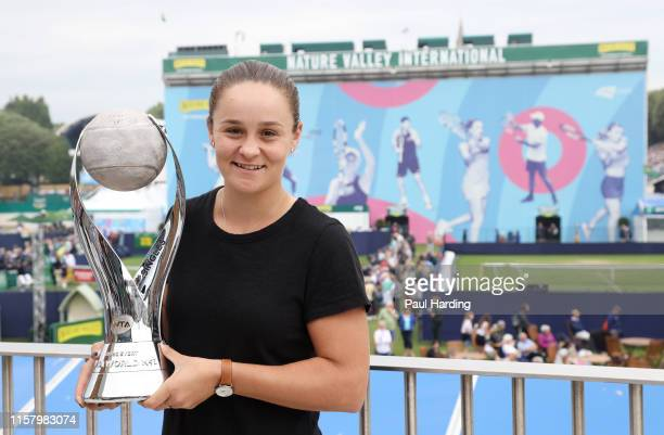Ashleigh Barty of Australia poses with the WTA World number 1 trophy during day 1 of the Nature Valley International at Devonshire Park on June 24...