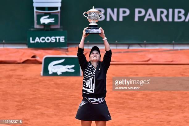 Ashleigh Barty of Australia raises the Suzanne Lenglen Cup after winning her womens singles final match against Marketa Vondrousova of Czech Republic...
