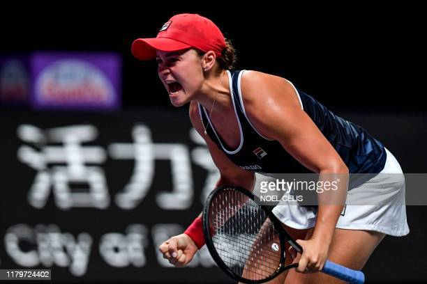 Ashleigh Barty of Australia reacts after winning against Elina Svitolina of Ukraine in their women's singles in the WTA Finals tennis tournament in...