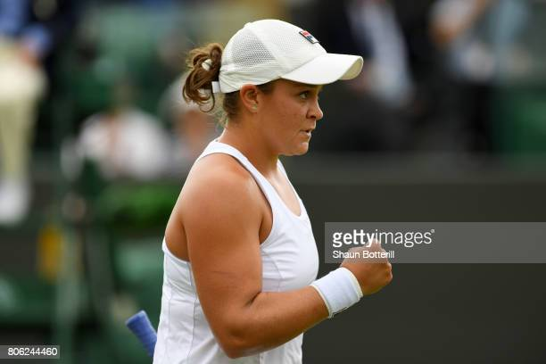 Ashleigh Barty of Australia reacts during the Ladies Singles first round match against Elina Svitolina of Ukraine on day one of the Wimbledon Lawn...