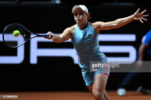 Ashleigh Barty of Australia returns a forehand on day 5 of the Porsche Tennis Grand Prix match between Ashleigh Barty of Australia and Laura...