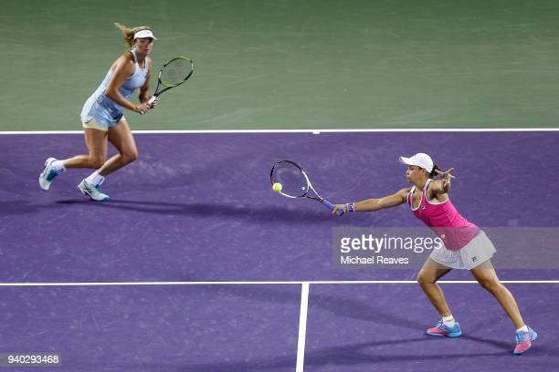 Ashleigh Barty of Australia returns a shot against Ekaterina Makarova and Elena Vesnina of Russia while playing with CoCo Vandeweghe of the United...