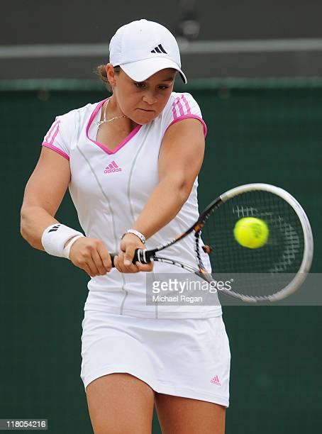 Ashleigh Barty of Australia returns a shot during her final round Girls' match against Irina Khromacheva of Russia on Day Thirteen of the Wimbledon...