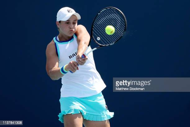 Ashleigh Barty of Australia returns a shot to Samantha Stosur of Australia during the Miami Open Presented by Itau at Hard Rock Stadium March 23 2019...