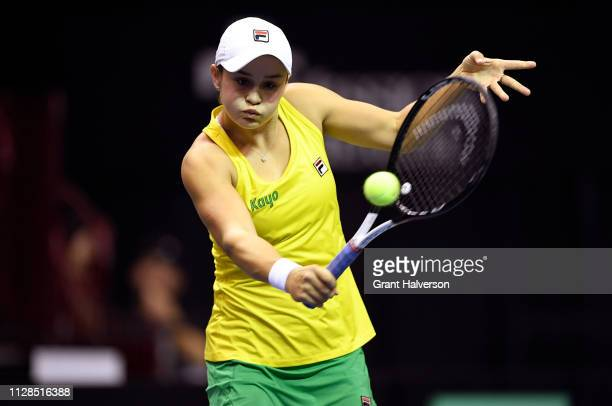 Ashleigh Barty of Australia returns a shot to Sofia Kenin of USA during the first round of the 2019 Fed Cup at US Cellular Center on February 09 2019...