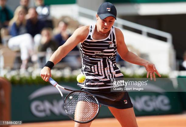 Ashleigh Barty of Australia returns the ball in the ladies singles final against Marketa Vondrousova of The Czech Republic during Day fourteen of the...