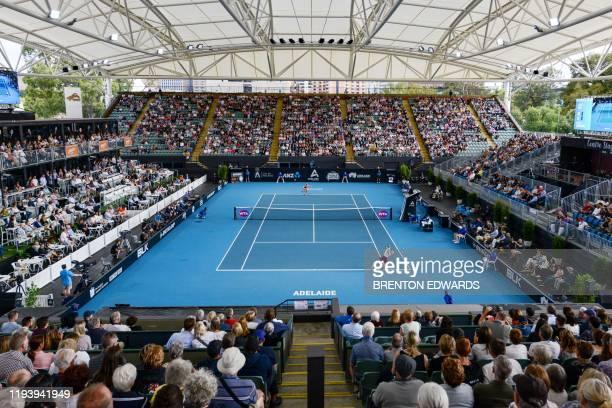 Ashleigh Barty of Australia serves against Marketa Vondrousova of Czech Republic during their women's singles quarterfinal match at the Adelaide...
