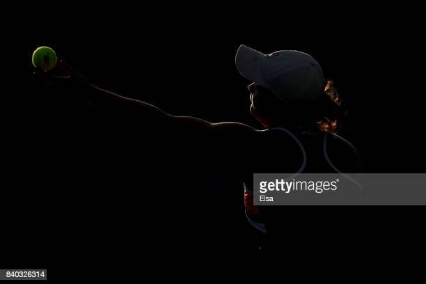 Ashleigh Barty of Australia serves during her first round Women's Singles match against Ana Konjuh of Croatia on Day One of the 2017 US Open at the...
