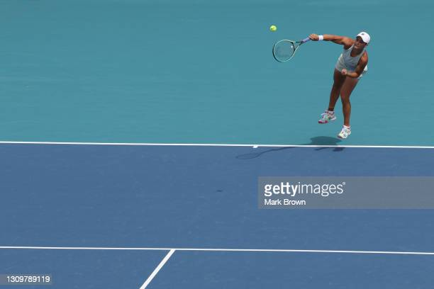 Ashleigh Barty of Australia serves during her women's singles fourth round match against Victoria Azarenka of Belarus on Day 8 of the 2021 Miami Open...