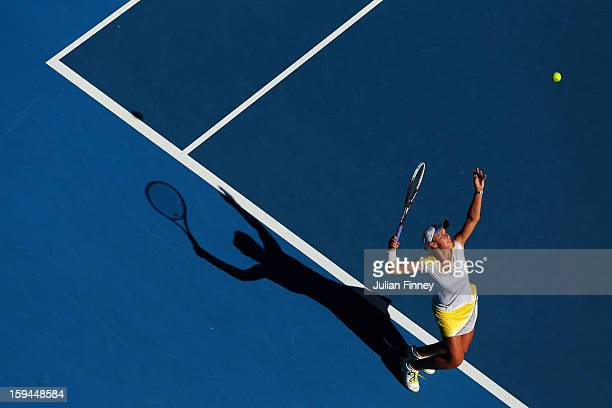 Ashleigh Barty of Australia serves in her first round match against Dominika Cibulkova of Slovakia during day one of the 2013 Australian Open at...